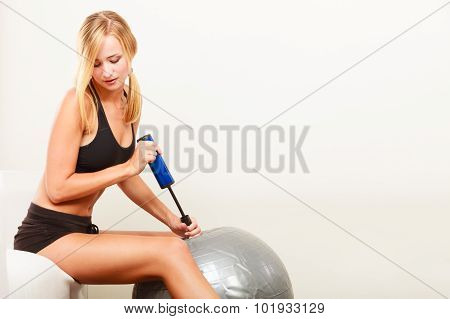 Fitness Woman With Air Pump Inflating Fit Ball