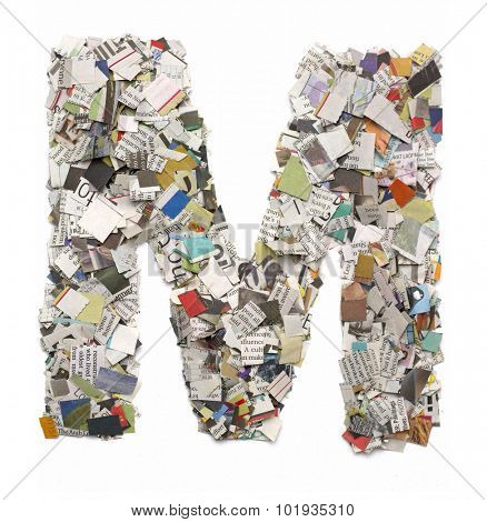 The letter  M  made from newspaper confetti