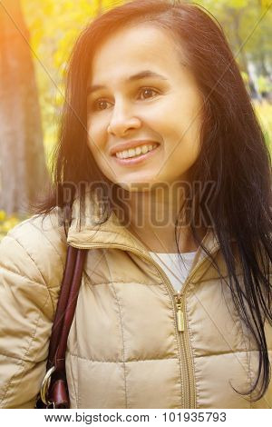 Happy Young Beautiful Woman In Autumn Park