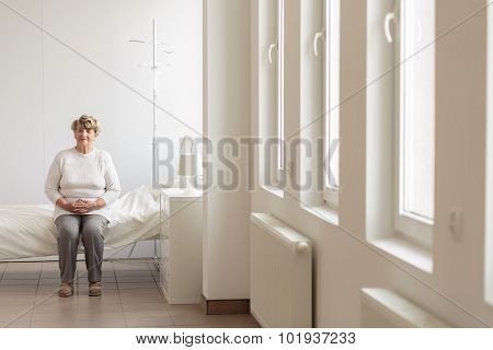 Senior Woman In Hospital Room