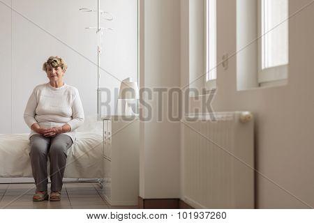 Elder Lady In Hospital Room