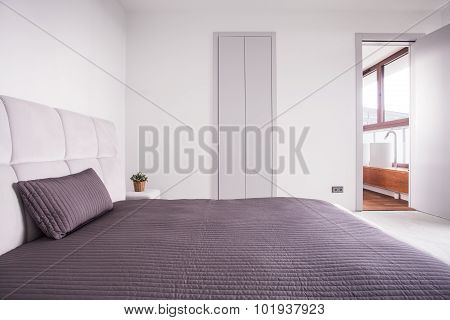 Beige Bedclothes In Bright Bedroom