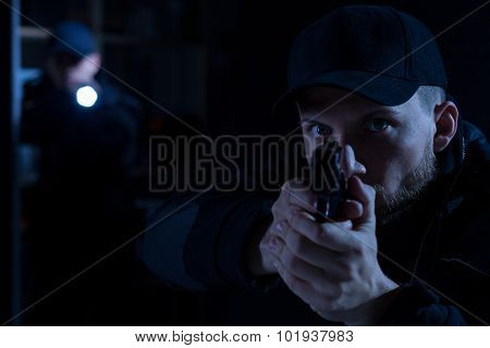 Officer Pointing Gun At Criminal