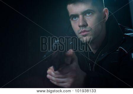 Cop Holding Pistol
