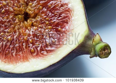 Half Fig, Macro Shot Shows The Juicy Pulp With Seeds