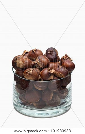 Roasted chestnuts in a glass dish