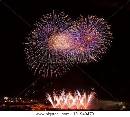 Colourful fireworks isolated in dark background close up with the place for text, Malta