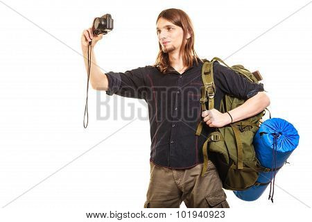 Male Tourist Backpacker Taking Photo With Camera