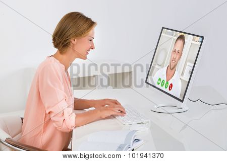 Woman Videochatting On Computer