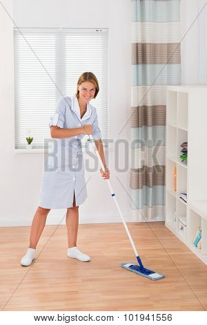 Female Janitor Mopping Floor