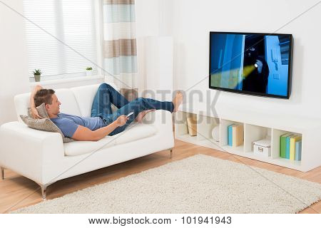 Man Watching Movie On Television