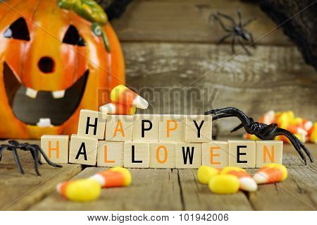 Happy Halloween wooden blocks with candy corn and decor