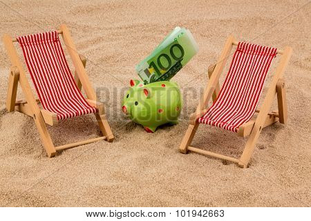 deckchair with euro currency on the sandy beach. symbol photo for costs in travel, vacation, holiday