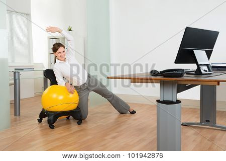 Businesswoman Doing Fitness Exercise On Pilates Ball
