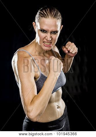Close up Aggressive Athletic Woman in Combat Pose