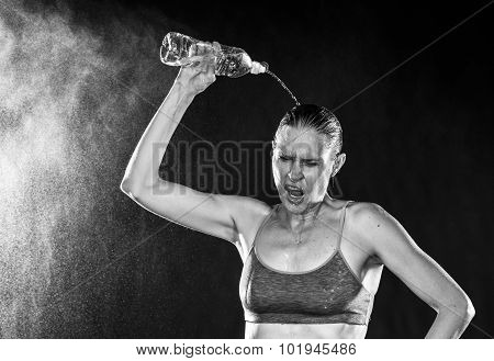 Tired Athletic Woman Pouring Water Over Head