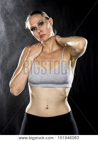 Serious Athletic Woman with Hands on her Neck