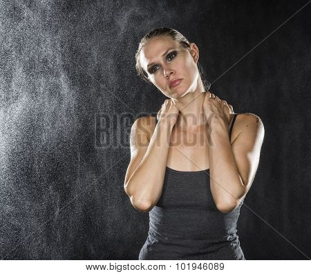 Pensive Athletic Woman Holding her Neck
