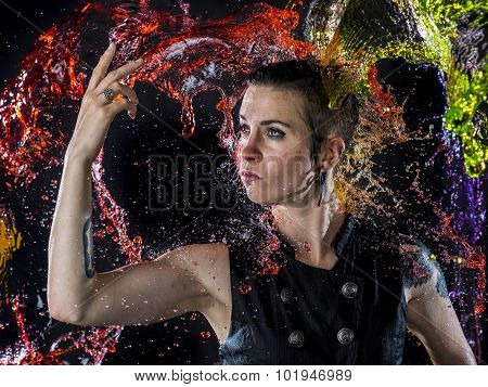 Modern Woman Being Splashed with Colorful Water