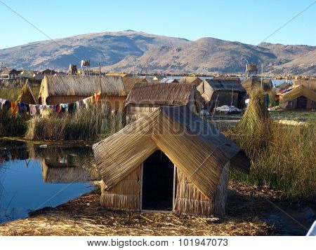 Traditional home on the floating island of Uros, Lake Titicaca, Puno, Peru.
