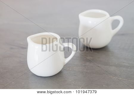 White Ceramic Pitcher On Grey Background