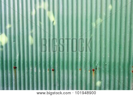 old zinc wall, green background
