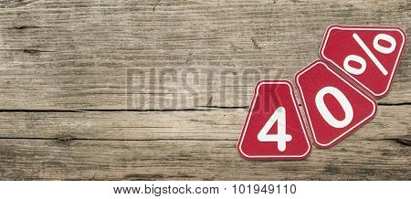 Forty percent off discount - price tag on rustic old wooden background