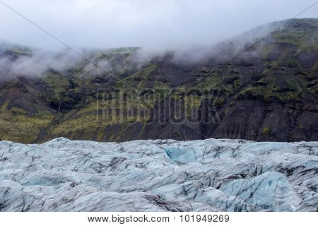 Glacier moving down the mountains in Fjallsarlon, Iceland