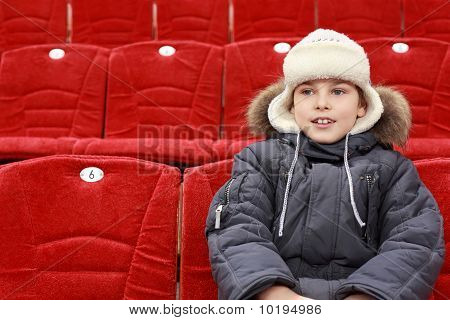 Boy Sits In Expectation Of  Hockey Match
