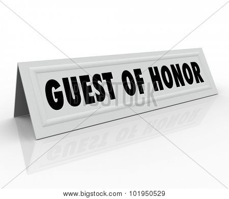 Guest of Honor words on a name tent card or placeholder reserving a seat for a dignitary or to welcome a keynote speaker