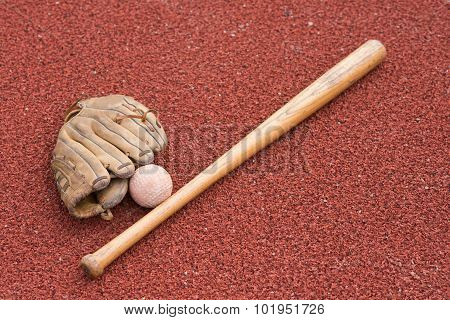 Baseball Bat With Ball And Glove On A Rubber Background