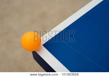 Pingpong Ball Hits The Corner Of A Blue Pingpong Table