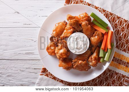 Buffalo Chicken Wings With Sauce And Celery.horizontal Top View