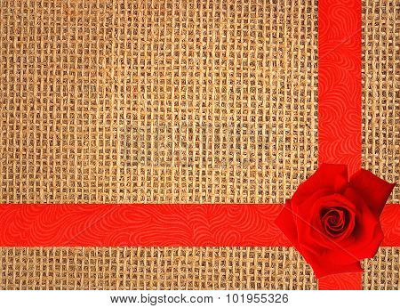 Red Rose On Linen Texture Background With Red Ribbon