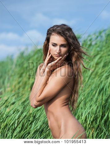 Nude Woman On Nature Background
