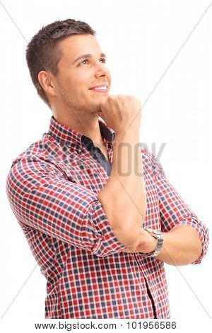Vertical studio shot of a young man in a red checkered shirt looking up and contemplating isolated on white background