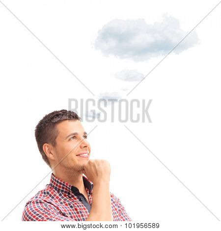 Young pensive man contemplating something with a cloud floating over his head isolated on white background