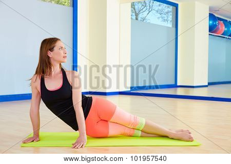 Pilates woman snake exercise workout at gym indoor