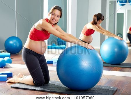 pregnant woman pilates fitball exercise workout at gym indoor