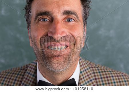 Nerd silly retro man with braces funny expression showing teeth