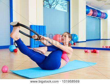 Pilates woman single leg stretch magic ring exercise workout at gym indoor