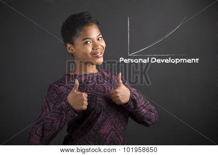African American Woman With Thumbs Up Hand Signal To Personal Development On Blackboard Background