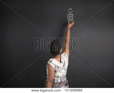 African American Woman Teacher Or Student Reaching Up To A Globe