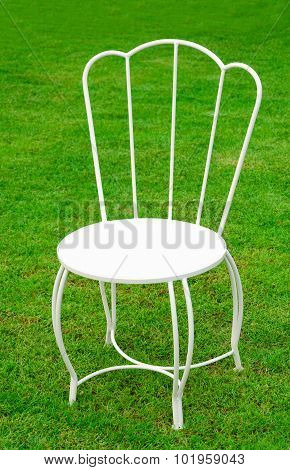 white chair on nature green field grass