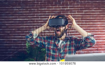 Shocked editor using 3D video glasses in office