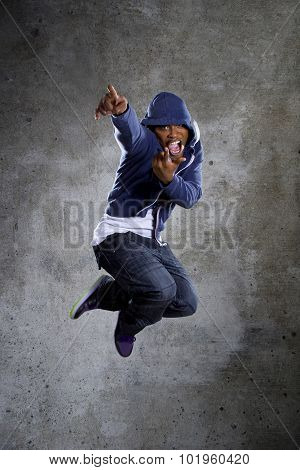 Fashionable Man in Hoodie Jumping