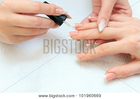 manicure making - female hands, covering of enamel