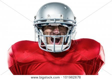 Portrait of aggressive American football player in red jersey screaming against white background