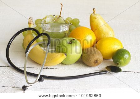 Stethoscope and fresh fruits diet concept