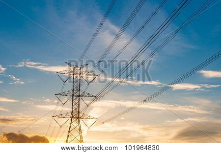 High Voltage Transmission Lines On Orange And Blue Sky, Sunrise Period